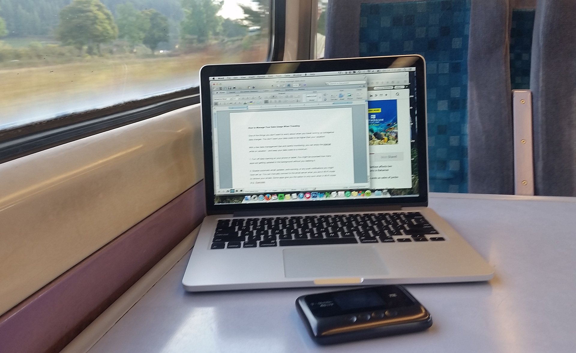 Working on train with laptop and pocket wifi device